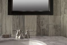 Wood look tile adds the warmth of wood but is perfectly practical behind a sink