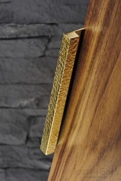 Joseph Giles hammered edge pull on walnut door