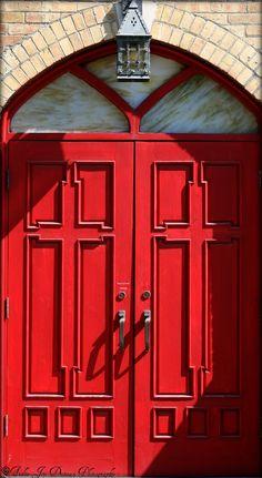 Beautiful red cross Church doors.