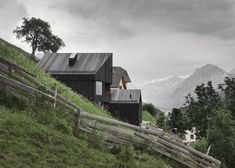 Alpine cabins that combine traditional elements with modern detailing.