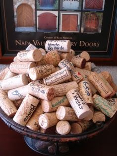 Write the date & what you were doing on corks when you open a bottle of wine- display in vase!  I LOVE THIS!