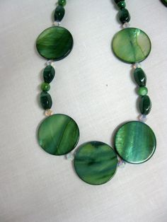 43 - Mystique - Green River Shell Beads and Crystal Swarovski Beads. $26.00, via Etsy.