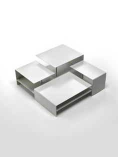 Living divani (art direction Piero Lissoni): 2B occasional table, a small scale architecture offering different perspectives of tops movable among different heights' panels, by young designer Victor Vasilev.