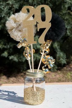 2017 Graduation Party Mason Jar Table Centerpiece. This glitter dipped 'Class of 2017' mason jar makes a great table centerpiece for graduation. It will create a stunning visual effect with the gold glitters. Graduation Party Decoration Ideas - Listing More