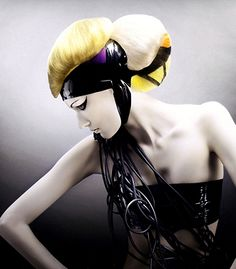 A long black straight coloured quirky avant garde Multi-Tonal hairstyle by D Ambrose