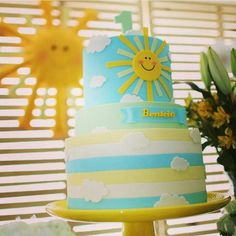 another cute cake/ with blue's and yellows and clouds