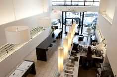 Clear Optometry Store - Interior Design Idea in San Francisco CA. Interesting with the space being half optical and half cafe! That would be my dream office; I could practice optometry and run a tea shop in the same space.