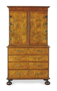 A GEORGE I FIGURED WALNUT, CROSSBANDED AND FEATHERBANDED SECRETAIRE-CABINET…