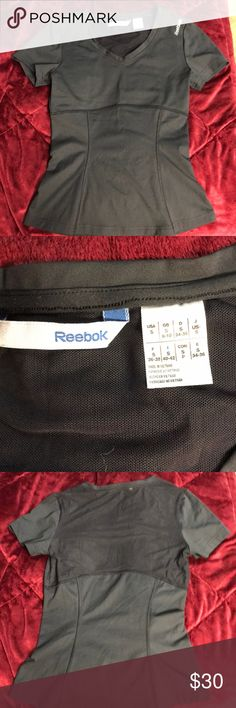 Reebok fitted shirt Black Reebok fitted exercise top. Size Small. Worn once, but not really my style. Mesh upper half of back. Polyester and nylon material. Reebok Tops Tees - Short Sleeve #fitnessexercises