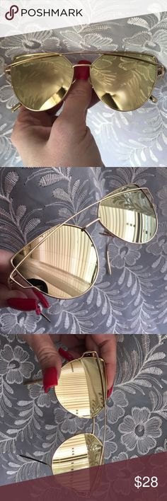 "CASE INCLUDED Gold Mirror/Gold Frame Cross Wire Gold mirror lenses. Gold color frame. Approximately 5 3/4"" across from outermost angle/outermost angle. Each lens vertically, 2"". Oversize appearance. Seller not responsible for fit nor comfort. Plastic frames and lenses. Small lens cloth and zipper case included. Brand new retail w/o tag. I do not model sunglasses. No trades, no App transactions.  7 COLORS AVAILABLE IN THIS STYLE      PRICE IS FIRM UNLESS BUNDLED                    5% off…"
