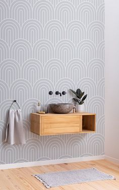 Achieve a goregeously grey bathroom by pairing the Hairpin wallpaper with more grey decor pieces. This aesthetic is timeless and trendy, as is the modern art deco inspired Hairpin wallpaper on this powder room wall. Wallpaper Art Deco, How To Hang Wallpaper, Normal Wallpaper, Adhesive Wallpaper, Pattern Wallpaper, Striped Wallpaper Gray, Geometric Wallpaper, Standard Wallpaper, New Bathroom Ideas