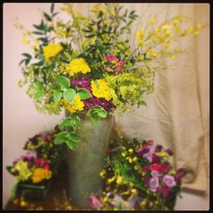 Colorful bucket- o-flowers! Orchids, yarrow, sweet William, Italian runs us, periwinkle and euphorbia Create a fresh and festive Wild Flower feel!