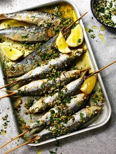 Grilled sardines with coarsely chopped green herbs from Rick Stein Fish & Shellfish, shot by James Murphy Photography