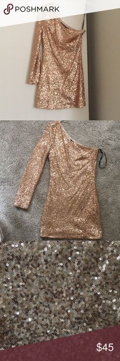 Nasty Gal Gold Sequin One Shoulder Dress Gold sequin one shouldered dress purchased from Nasty Gal (before Nasty Gal was taken over by new ownership). This dress is lined. Only worn a few times. Length is 31.5 inches (measured from top of shoulder to bottom hem) Nasty Gal Dresses One Shoulder