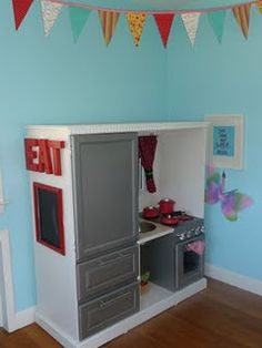 DIY Play kitchen out of the older tv entertainment center