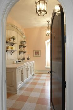 laundry room! Gorgeous floor and fab wall color/cabinetry and millwork.