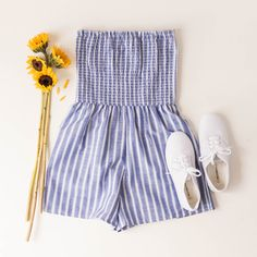 striped romper, blue, white, striped, stripes, vertical stripes, sleeveless, ruched, scrunched, shirred, white sneakers, white tennis shoes, lace up sneaks, The Copper Closet, fashion, boutique, clothing, affordable, style, woman's fashion, women fashion, online shopping, shopping, clothes, girly, boho, comfortable, cheap, trendy, outfit, outfit inspo, outfit inspiration, ideas, Jacksonville, Gainesville, Tallahassee Florida, photo shoot, look book