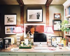 My kind of workspace: large table. stuff. mini gallery wall.