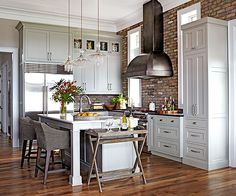 Earthy textures and unique details make this relaxed country kitchen a magnet for guests.