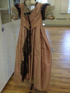 1861-4 Evening dress in rose pink taffeta with fine double stripes woven in black Gallery of English costume, Manchester