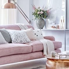 Layer soft rose pink with grey choose a classic sofa as the rooms centrepiece then introduce pattern with decorative cushions and a rug. Contrast the soft colours with a statement floor lamp and coffee table. #livingroom #interiors #styletip #homedecor #livingroomdecor #interiordesign #homesweethome #interiorstyling #interiorinspiration #prettyinpink by housebeautifuluk