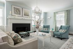 "Love this blue living room. Paint color is ""Borrowed Light"" by Farrow & Ball."