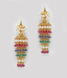 Various kinds of jhumkis/earrings from Mangatrai jewellers.. For more details visit www.mangatraionline...