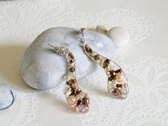 Items similar to Elegant asymmetrical wirework earrings in cream and brown colours on Etsy Handmade Jewelry, Handmade Items, Unique Jewelry, Handmade Gifts, Tarnished Silver, Wire Work, Copper Wire, Beautiful Necklaces, Crystal Beads
