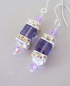 I created these elegant purple crystal earrings with 8mm Swarovski Tanzanite cube crystals nestled between sparkly Swarovski clear crystal square
