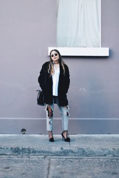 If you've been on Instagram, Pinterest, or Tumblr at all in the last few weeks, then you've probably noticed a random and very specific trend has popped up: wearing fishnet stockings under ripped jeans. Or with oversized shirts and sweaters. Or with skirts. Or with… anything. Yes, it's true: fishnet stockings have made a major comeback, and they're becoming bigger each day.
