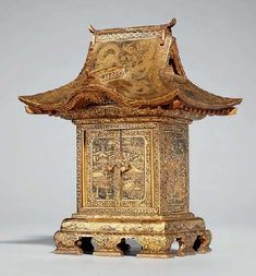 A CABINET, Fuji mark of the Komai workshop, late 19th century. In the form of a temple, decorated in gilt nunomezogan, the roof chased with dragons, pheasants and ho-o birds, the two hinged doors open to reveal three small drawers engraved with village landscapes, wood stand 15.8cm high. This was sold at $ 15,600 at Christie's Zurich on 19 February 2007.