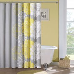 Elegant and inviting, this sateen printed shower curtain will add a stylish touch to any bathroom. Its fun design features white and yellow flowers that fade into a soft gray color. It is also 100 percent cotton and fully machine washable.