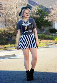 Shop this look on Lookastic:  http://lookastic.com/women/looks/skater-skirt-crew-neck-t-shirt-necklace-hat-ankle-boots/8700  — White and Black Vertical Striped Skater Skirt  — Charcoal Print Crew-neck T-shirt  — Silver Necklace  — Teal Wool Hat  — Black Suede Ankle Boots