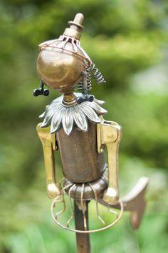 Garden art figure from recycled metal parts via empressofdirt.net / photo - flickr