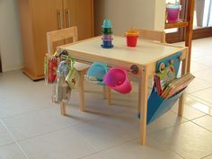 Materials: Latt, Bygel rail and containerDescription: I used clear water based varnish to make the table and chair washable. Then I added the Bygel rail and containers on one side of the table. I also applied knobs made of wood for my handmade magazine rack made of blue polycarbonate. See more of the embellished Latt …
