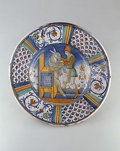 Dish (piatto): Man Washing the Mouth of an Ass  Date: ca. 1550–60  Medium: Maiolica (tin-glazed earthenware)  Accession Number: 1975.1.1039  On view at The Met Fifth Avenue in Gallery 950 / Collection | The Metropolitan Museum of Art