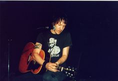 Elliott Smith - notice, he's using a Gibson and not his Yamaha. // wearing a Bocephus shirt (Hank Williams Jr.)