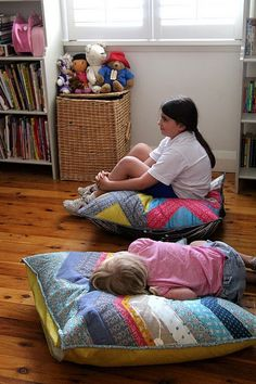 "*I want to try this for the kids :) ""Big quilted floor cushions. I think this would make a great keepsake for kids. I can picture a college freshman with one of these in their dorm room! Quilting Projects, Sewing Projects, Fabric Crafts, Sewing Crafts, Diy Crafts, Sewing Pillows, Quilted Pillow, Kid Spaces, Scraps Quilt"