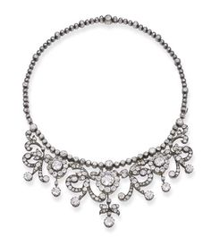 Antique Diamond Necklace, Designed As Diamond Clusters, Scrolls And Collets To The Diamond Collet Line, The Three Main Clusters Detaching To Form A Pair Of Earrings And A Pendant, Mounted In Silver And Gold   c.1900  -  Christie's
