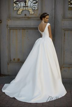 Gorgeous sleek bridal gown! Get it at Joy Abendmode in Royal Oak, Michigan!   Call 248-876-0833 for an appointment today!