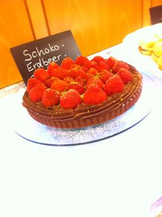 Dark chocolate mousse strawberry tart on soft baked white chocolate  pastry