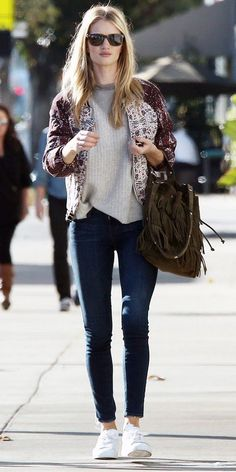 Rosie Huntington-Whiteley (model): bomber jacket + skinny jeans + white sneakers  via Tevi Boutique