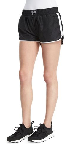 Logo-Front Mesh Training Shorts W/Stripe by Heroine Sport. Heroin Sport mesh training shorts with side stripes. Elasticized waist with logo. Vented at sides. Pull-on style. Pol...