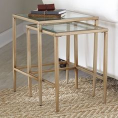 Showcasing a golden finish and sleek glass surface, this lovely End Table is perfect for anchoring a bold lamp and stack of glossy magazines.