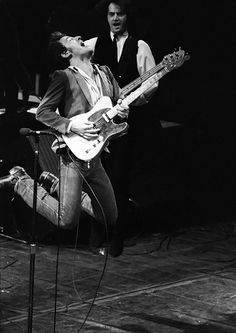 Bruce Springsteen jumps while playing guitar at the Winterland Arena in 1978.
