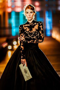 Marchesa Gown with Merci New York for Madame Mathilde Clutch Photograph by Casey Fatchett Photography http://www.storyboardwedding.com/queen-of-the-night-elegant-black-wedding-dresses-with-sophisticated-style/