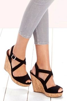 Black strappy platform wedges with a cork heel and peep toe