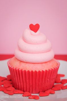I'd bake pastel colored cupcakes & decorate the tops with a coordinated Valentine conversation heart. Cute!