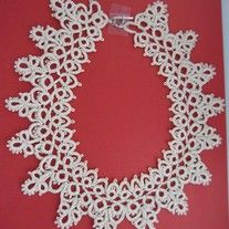 This ecru colored lace color would be an awesome touch of elegance to any simple outfit.