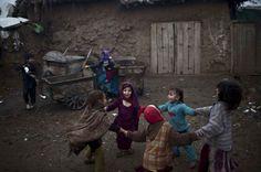 Afghan refugee girls play in a slum on the outskirts of Islamabad, Pakistan on February 2, 2015. (Muhammed Muheisen/AP)